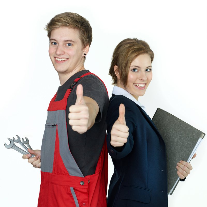 Apprentices for car mechanic and office having thumbs up