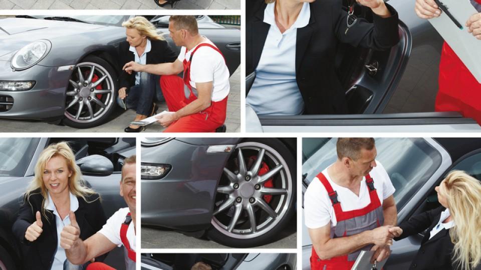 Auto mechanic – customer and motormechanic outdoors